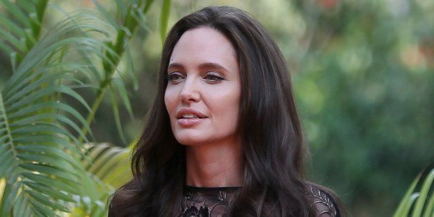 Actress Angelina Jolie arrives for a news conference at a hotel in Siem Reap province, Cambodia, February...