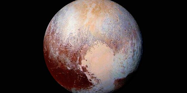This NASA's photo of Pluto was made from four images from New Horizons' Long Range Reconnaissance Imager...