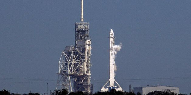 A SpaceX Falcon 9 rocket sits on the launch pad after being scrubbed due to a technical problem while...