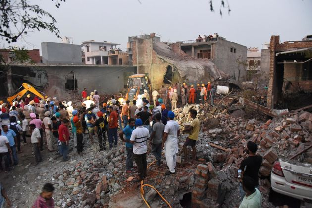 Rescuers work at the site of an explosion at a fireworks factory in Batala, Punjab, Wednesday, Sept....