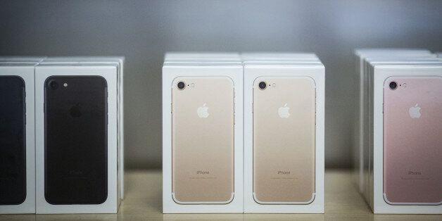 Boxes of iPhone 7 smartphones are displayed at an Apple Inc. in New York, U.S., on Friday, Sept. 16,...