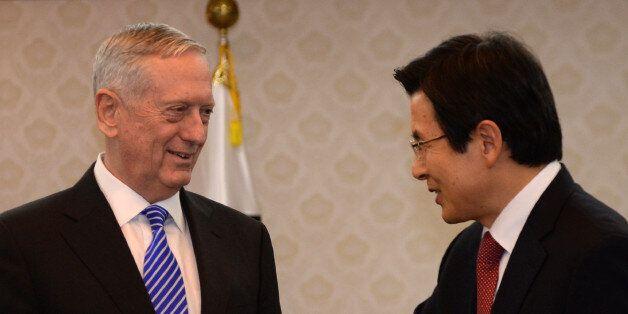 South Korea's acting President Hwang Kyo-ahn (R) greets US Defense Secretary James Mattis (L) prior their...