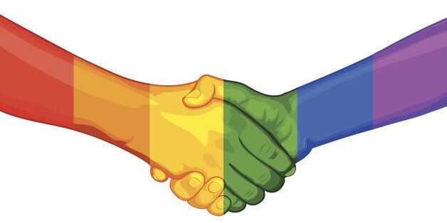 illustration of handshake with painted hand in rainbow flag LGBT