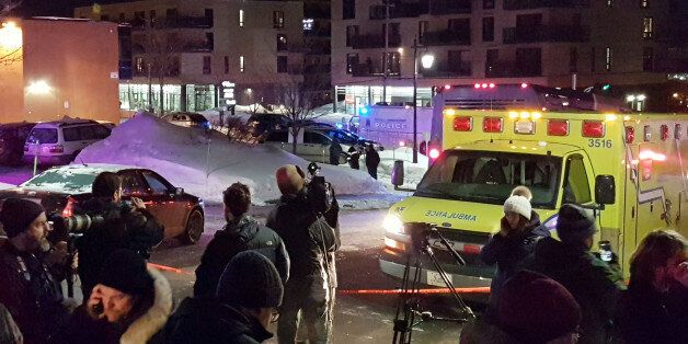 An ambulance is parked at the scene of a fatal shooting at the Quebec Islamic Cultural Centre in Quebec...