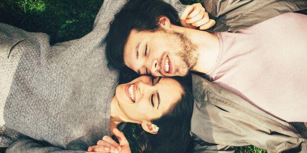 Happy young couple lying on the