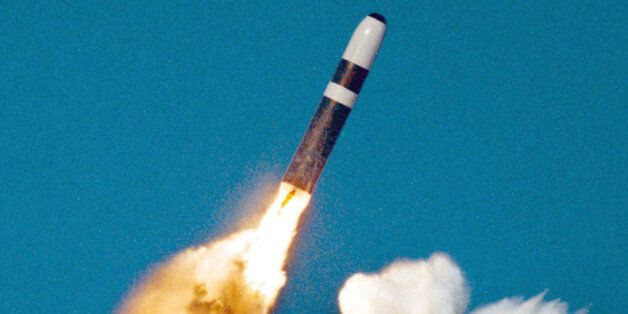 UNDATED PHOTO - A Trident II, or D-5 missile, is launched from an Ohio-class submarine in this undated...