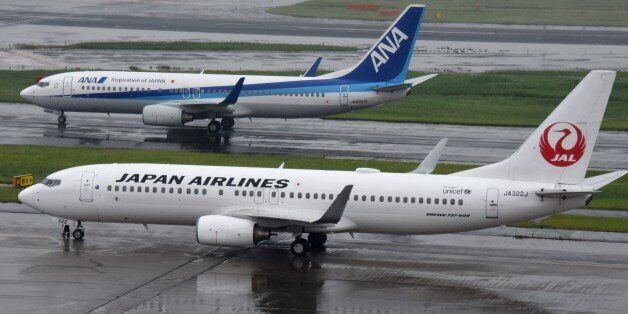 All Nippon Airways (ANA/top) and Japan Airlines (JAL/bottom) aircraft are seen at Haneda Airport in Tokyo...