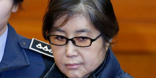 Choi Soon-sil (C), the woman at the centre of the South Korean political scandal and long-time friend...