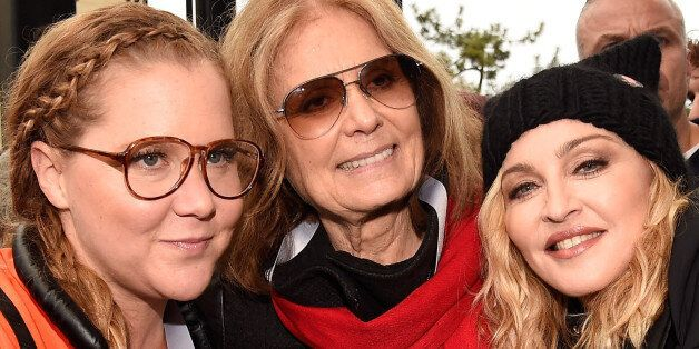 WASHINGTON, DC - JANUARY 21: (L-R) Amy Schumer, Gloria Steinem and Madonna attend the rally at the Women's...