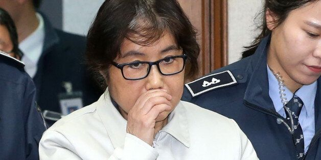 Choi Soon-Sil (C), who has been dubbed Korea's 'female Rasputin' for the influence she wielded over the...