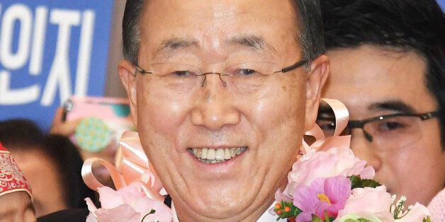 Former U.N. Secretary General Ban Ki Moon smiles after arriving at Incheon International Airport outside...