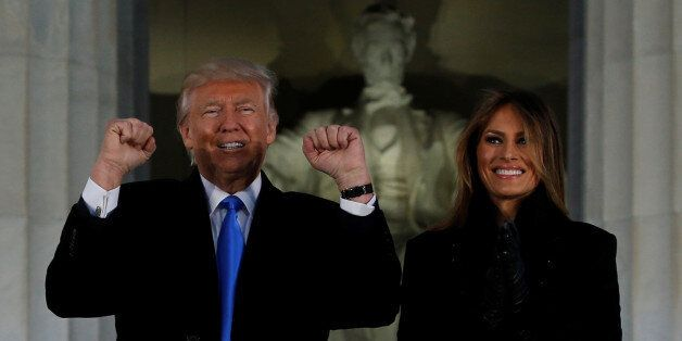 U.S. President-elect Donald Trump and his wife Melania take part in a Make America Great Again welcome...