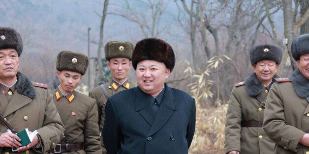 North Korean leader Kim Jong Un inspects a sub-unit under KPA Unit 233, in this undated photo released...