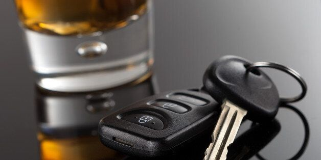 Alcoholic Drink resting next to a pair of car keys. Please do not drink and