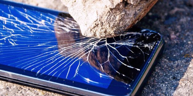 Cracked mobile smartphone savagely smashed by a