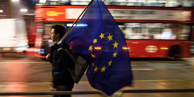 LONDON, ENGLAND - JANUARY 24: A man carries a European Union flag outside the Supreme Court in Parliament...