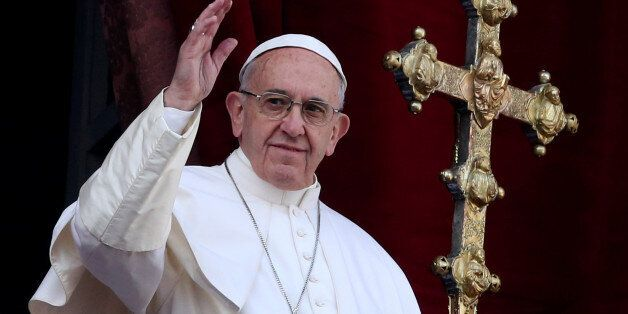 Pope Francis waves after delivering