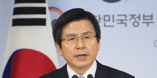 South Korean Prime Minister Hwang Kyo Ahn delivers an address to the nation as acting president in Seoul...