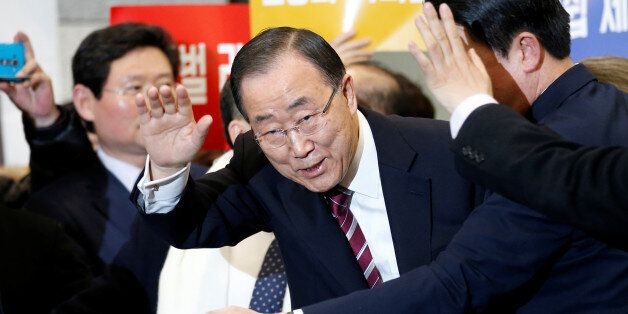 Former UN chief Ban Ki-moon waves to his supporters upon his arrival at the Incheon International Airport...