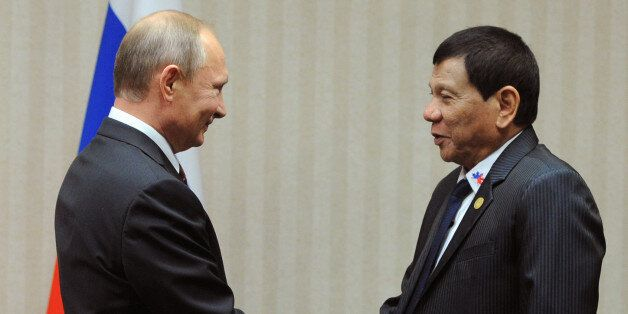 Russian President Vladimir Putin (L) meets with his Philippines' counterpart Rodrigo Duterte on the sidelines...