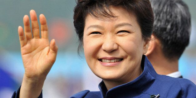 South Korean President Park Geun-Hye waves as she inspects troops during a ceremony marking the 65th...