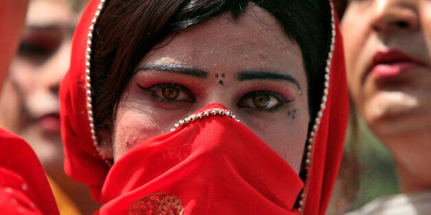 A Pakistani transvestite takes a part in a rally with others to support their arrested colleague Raani,...