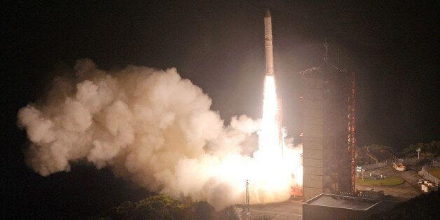 Japan's upgraded solid fuel Epsilon rocket lifts off from the Uchinoura Space Center in the town of Kimotsuki...