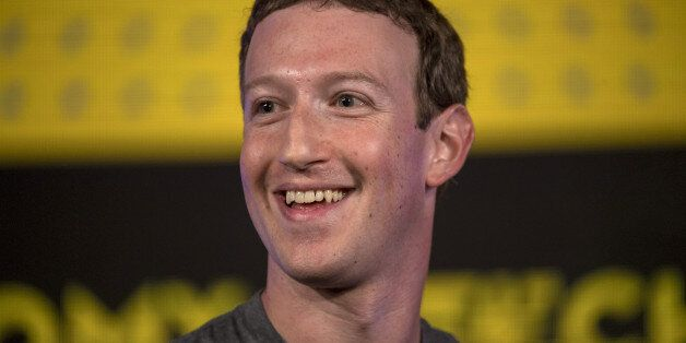 Mark Zuckerberg, chief executive officer and founder of Facebook Inc., reacts during a session at the...