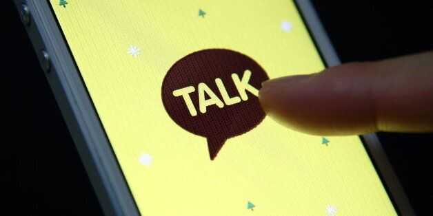 The logo of KakaoTalk, a messaging app developed by Kakao Corp., is displayed on an Apple Inc. iPhone...
