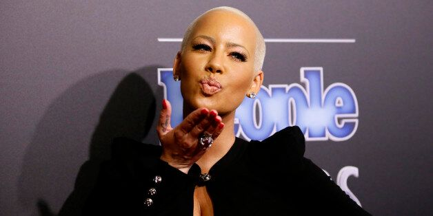 Model Amber Rose arrives at the People Magazine Awards in Beverly Hills, California December 18, 2014....