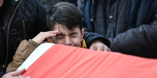ISTANBUL, TURKEY - JANUARY 1: Relatives and friends mourn at a coffin during the funeral of Ayhan Arik,...