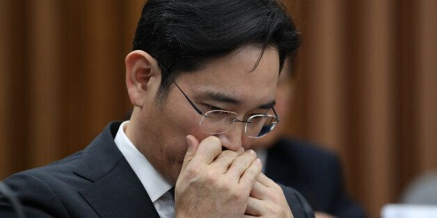 Jay Y. Lee, co-vice chairman of Samsung Electronics Co., applies lip-balm during a parliamentary hearing...