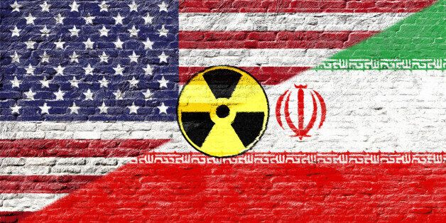 United states and Iran - National flags on Brick wall with nuclear