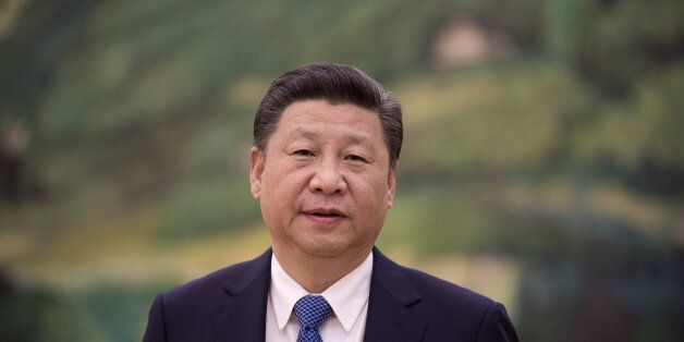 ASOURI BEIJING, CHINA - DECEMBER 02: China's President Xi Jinping looks on before a meeting with former...
