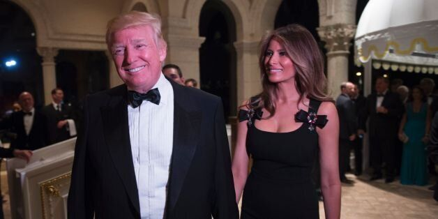 US President-elect Donald Trump arrives with his wife Melania for a New Year's Eve party December 31,...
