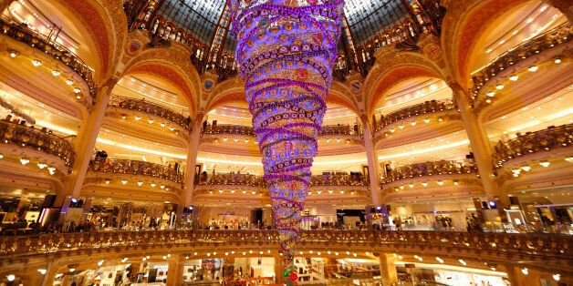 A giant Christmas tree installed upside down stands in the middle of the Galeries Lafayette department...