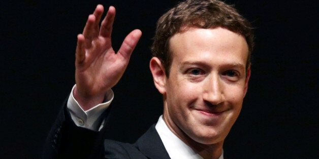 Facebook founder Mark Zuckerberg waves to the audience during a meeting of the APEC (Asia-Pacific Economic...