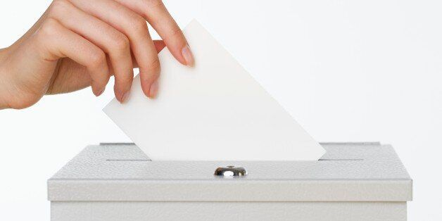 Close up of woman's hand putting card in box with