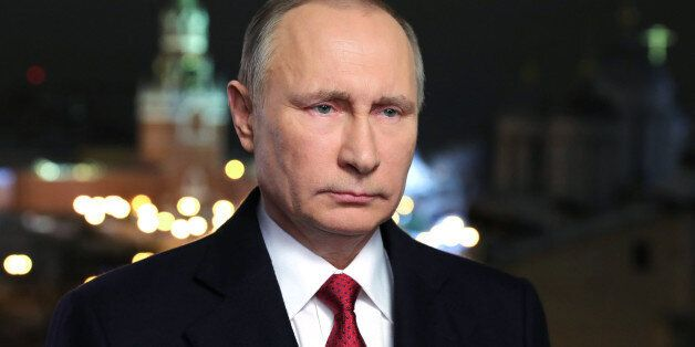 Russian President Vladimir Putin makes his New Year's address to the nation in Moscow's Kremlin, December...