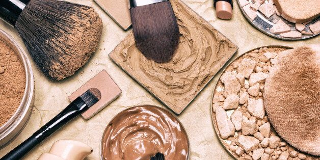 Makeup products to even skin tone and complexion on aged paper. Corrector, loose and compact powders,...