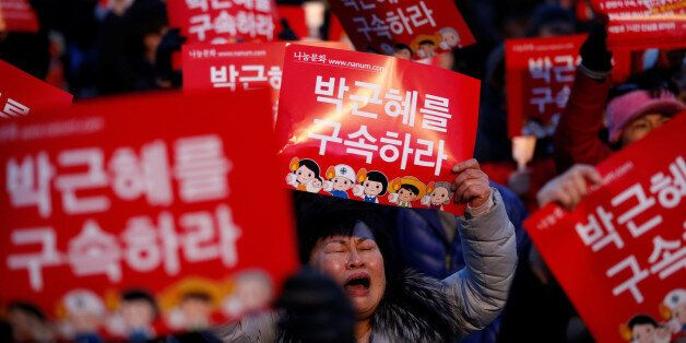 People attend a protest demanding South Korean President Park Geun-hye's resignation in Seoul, South...