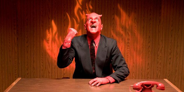 Businessman dressed as devil