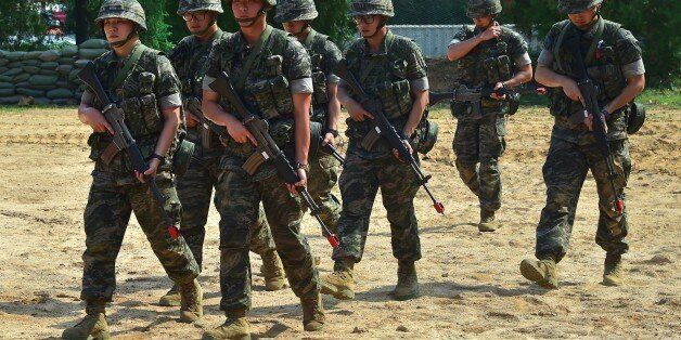 South Korean marines move after a demonstration during a press tour to General Outpost (GOP) of 2nd Marine...