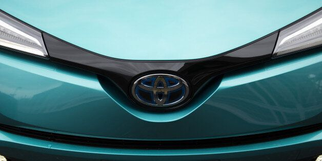 A Toyota Motor Corp. C-HR hybrid sport utility vehicle (SUV) is displayed in a parking lot during a media...