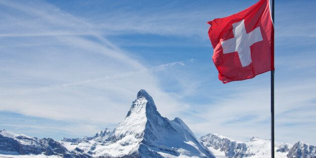 The Matterhorn Switzerland with swiss flag in Zermatt,