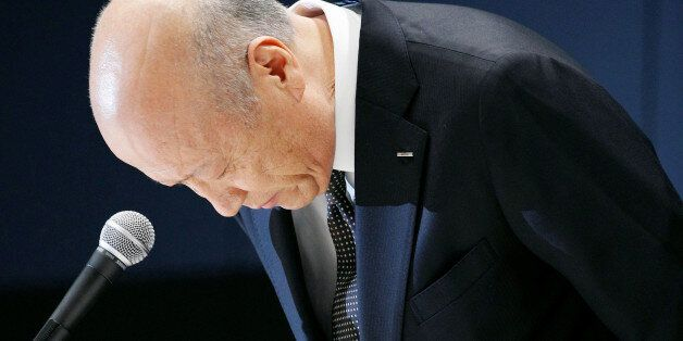 Tadashi Ishii, president of Japan's top advertising agency Dentsu Inc, bows during a news conference...