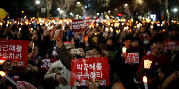 People march toward the constitutional court during a protest demanding South Korean President Park Geun-hye's...