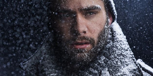 Cropped shot of a serious young man covered in snow in the