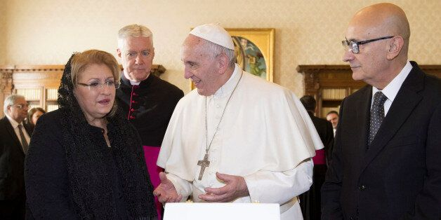 Pope Francis (C) exchanges gifts with President of Malta Marie Louise Coleiro Preca and her husband Edgar...