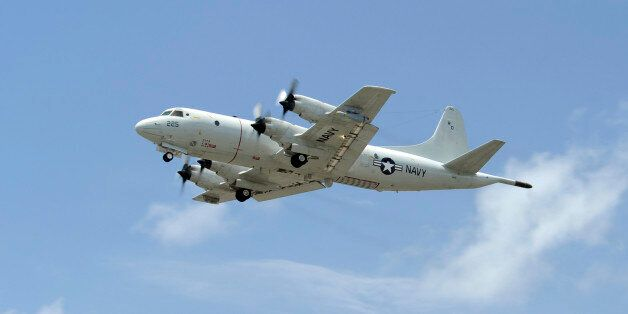 Kaneohe, Hawaii, July 14, 2012 - A P-3C Orion aircraft takes off from Marine Corps Base Hawaii to conduct...